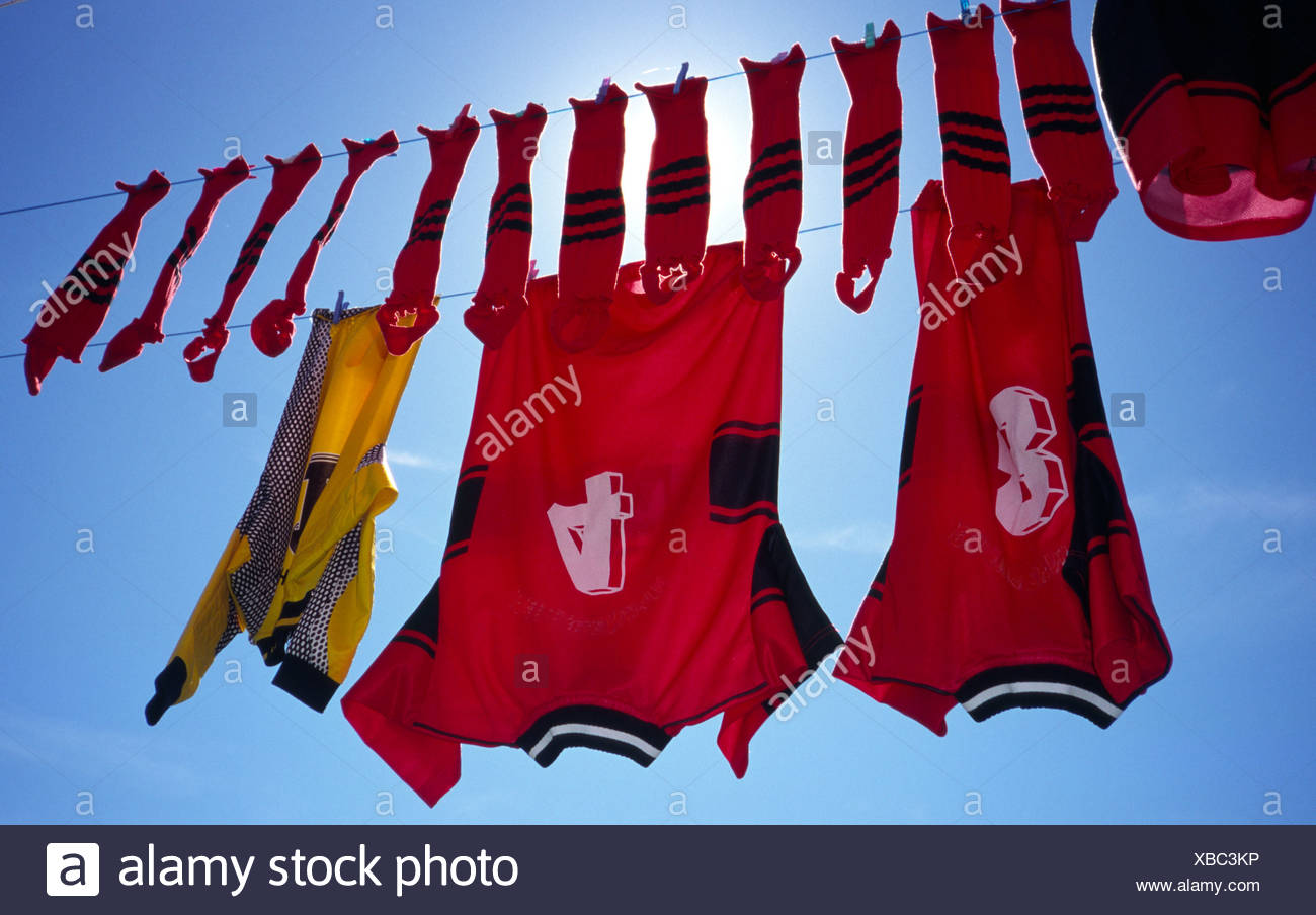 Low angle view of soccer uniform on clothesline - Stock Image