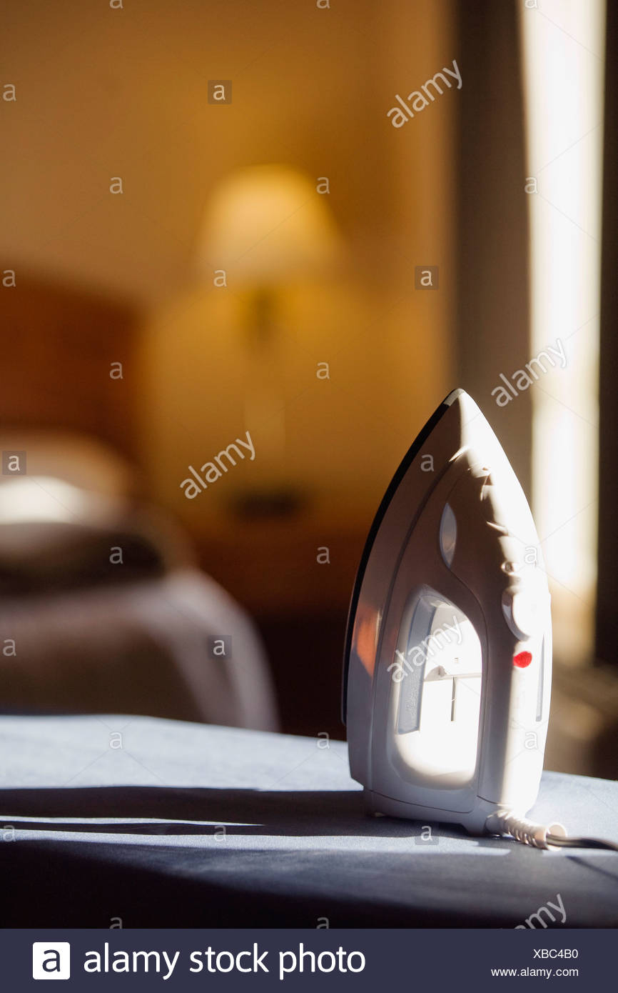 An iron and ironing board - Stock Image