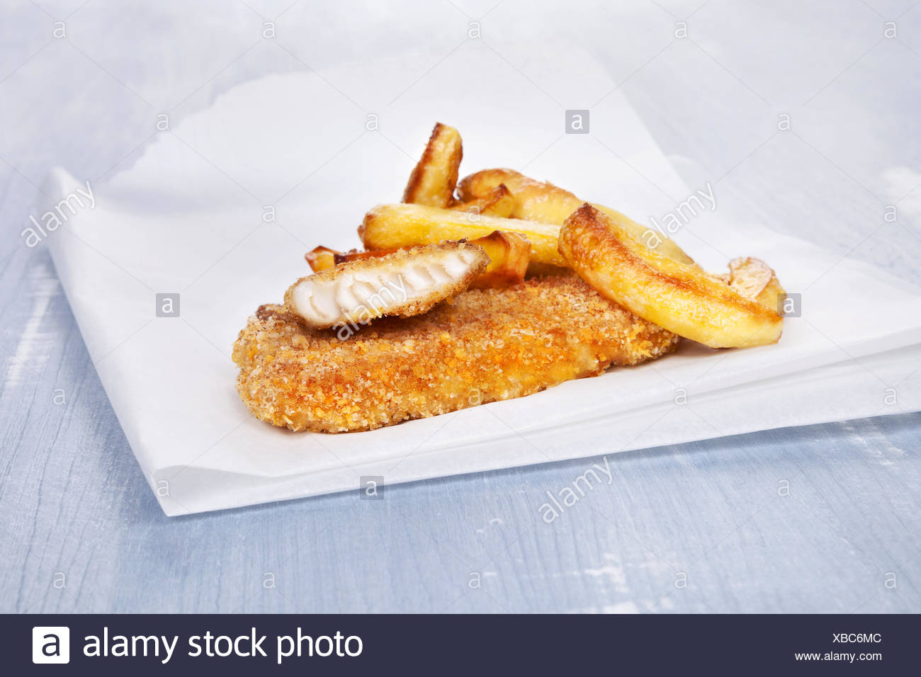 Luxurious fish and chips. - Stock Image