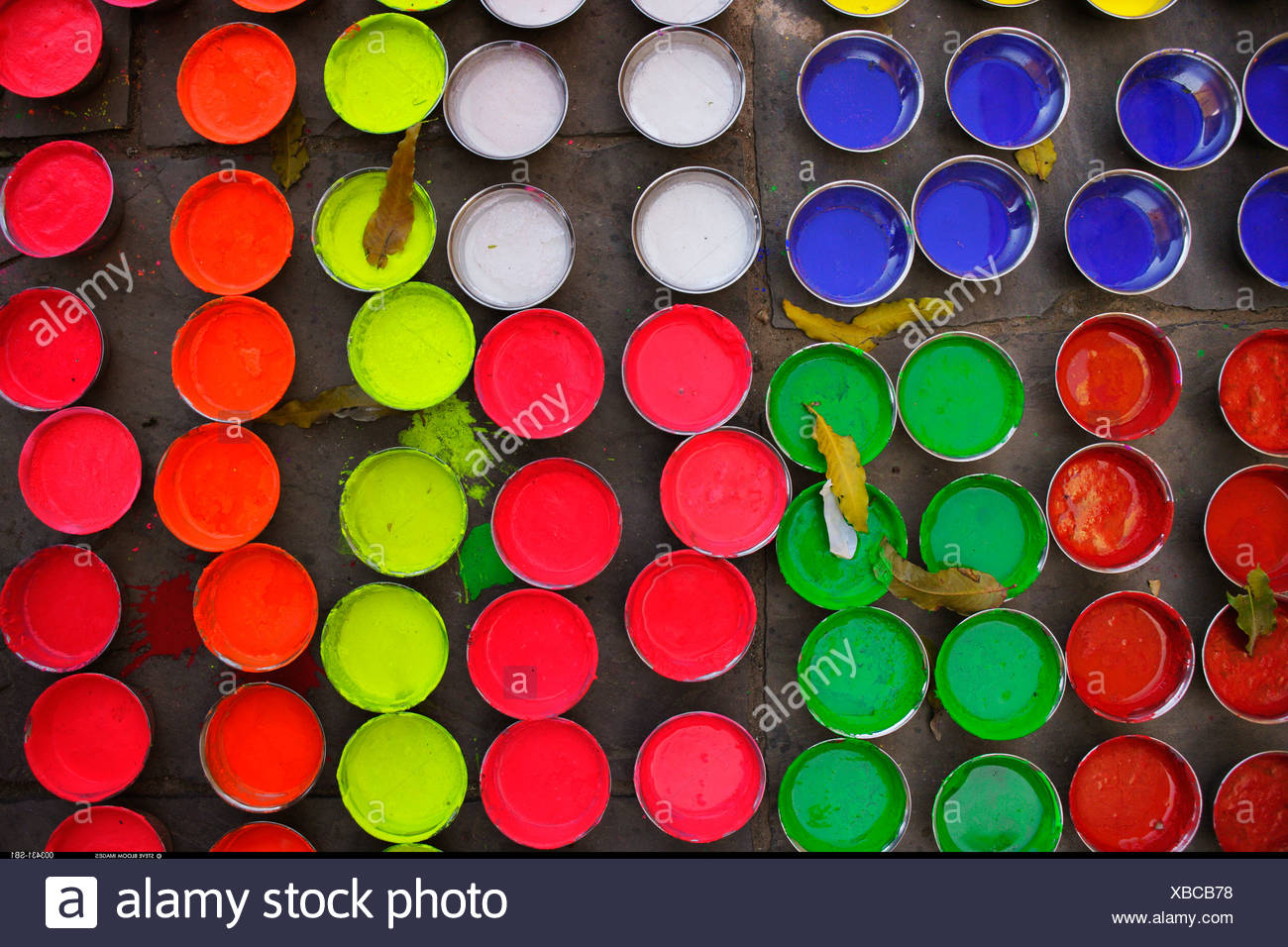 Pots of paint used for decoration of elephants for the Elephant Festival Jaipur India - Stock Image
