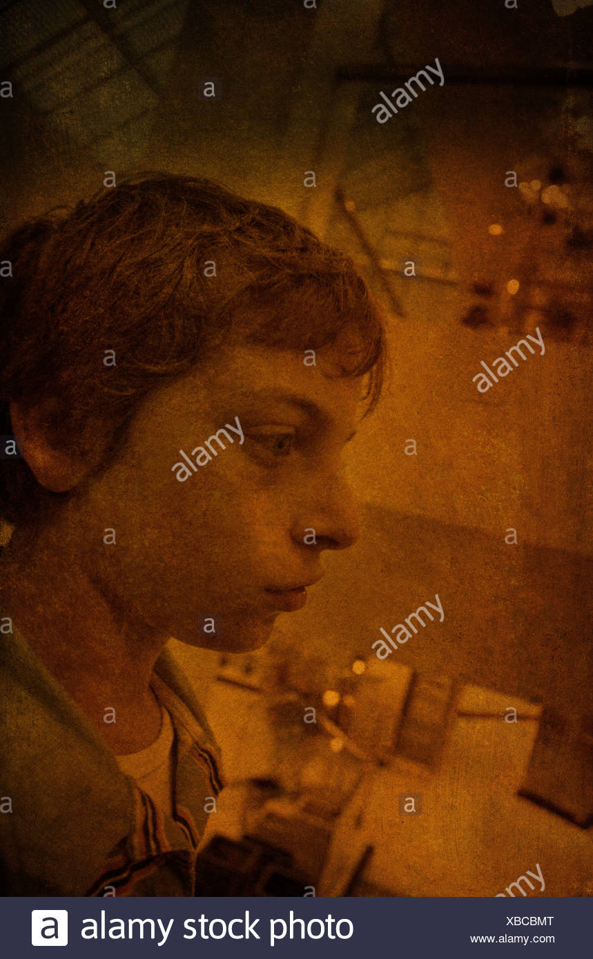 Young teenage boy in profile - Stock Image