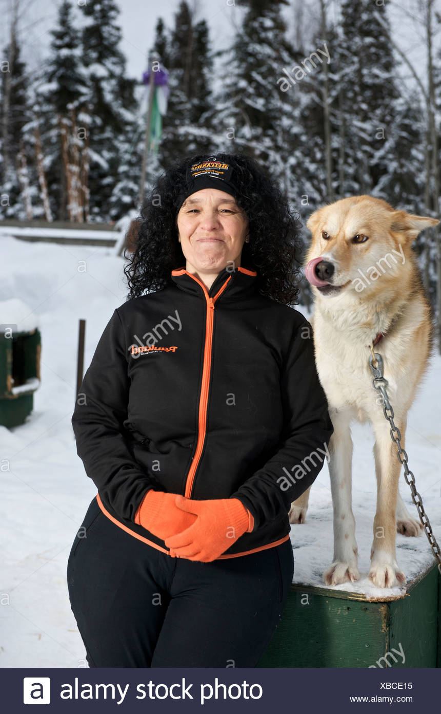 Woman musher with sled dogs. - Stock Image