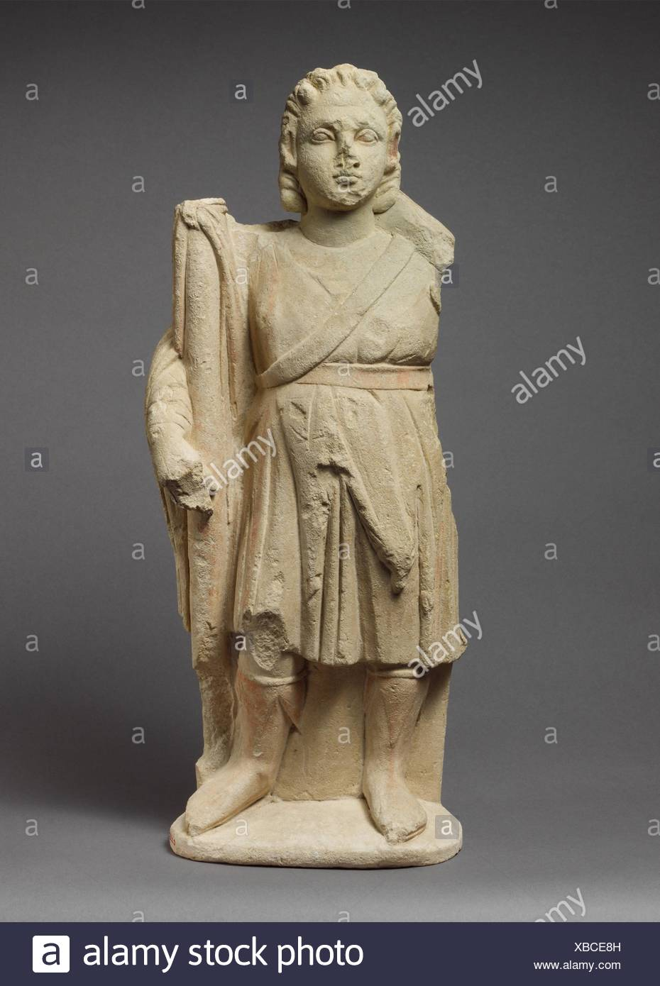 Limestone statuette of Dionysos holding a thyrsos. Period: Hellenistic; Date: 310-30 B.C; Culture: Cypriot; Medium: Limestone; Dimensions: H. 20 1/2 Stock Photo