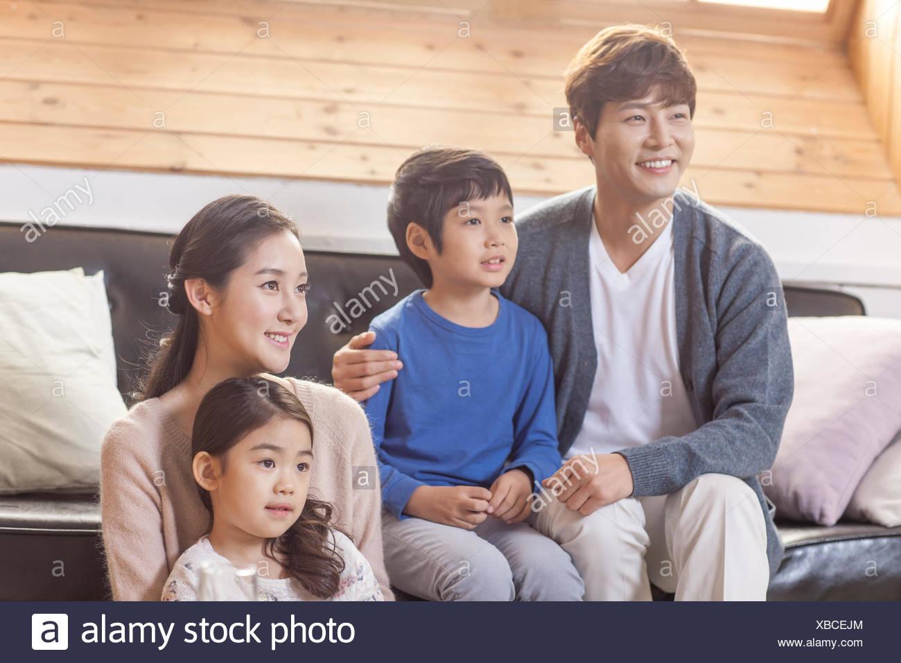 Harmonious family in living room - Stock Image
