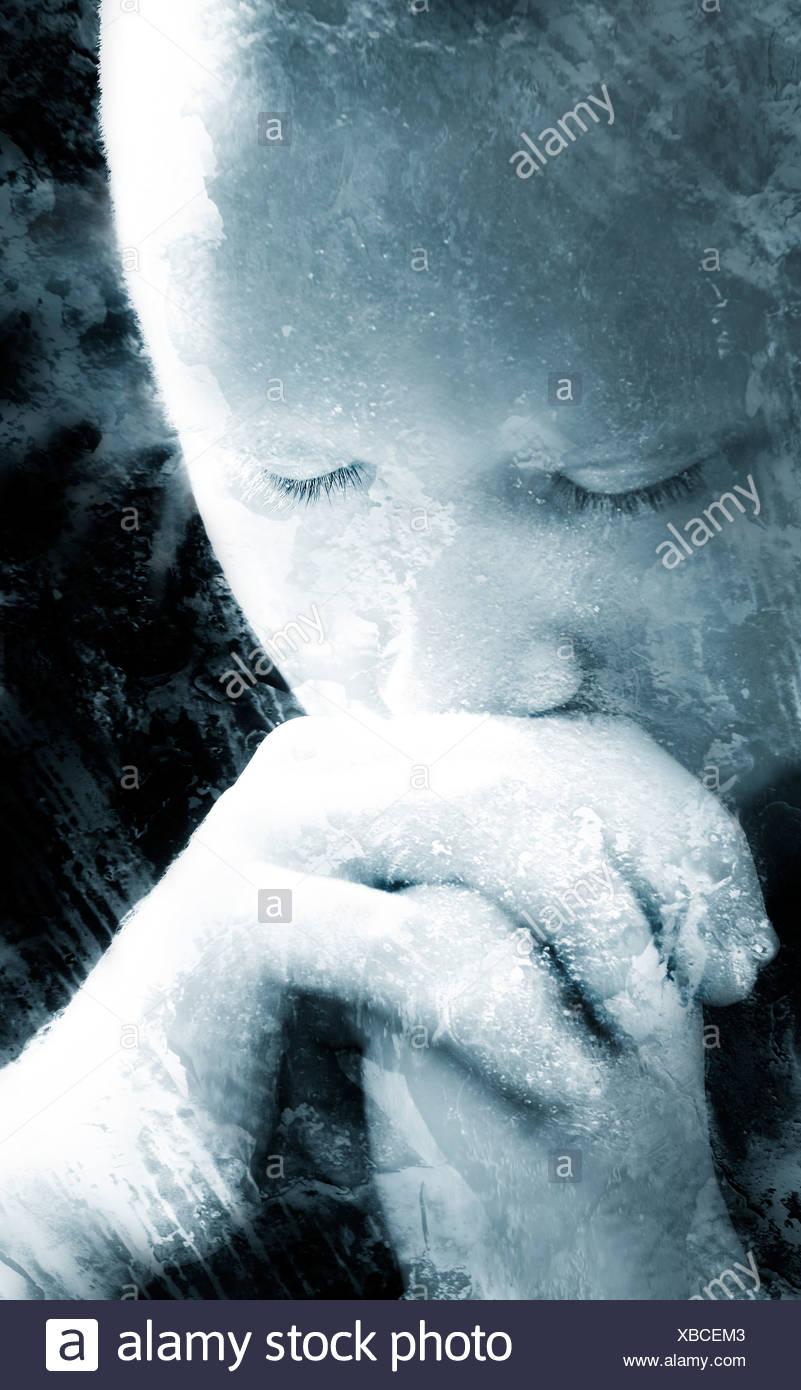 A man praying - Stock Image