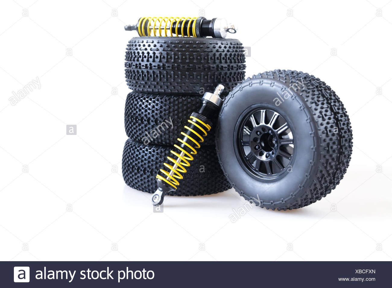 wheels and shock absorbers on a white background - Stock Image