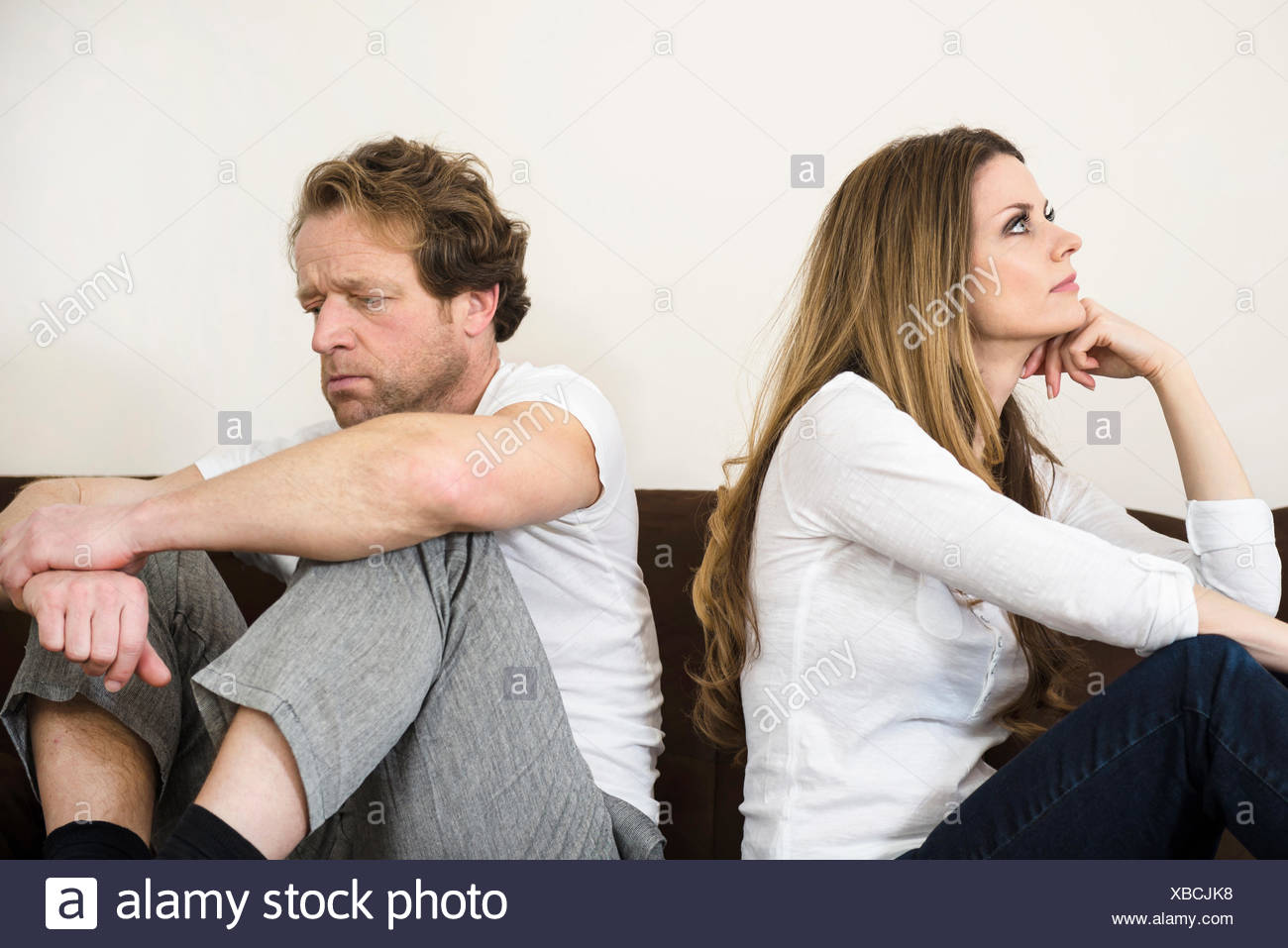 Quarreling couple in living room - Stock Image