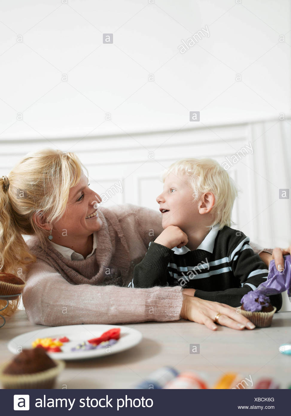 Family making Cupcakes - Stock Image