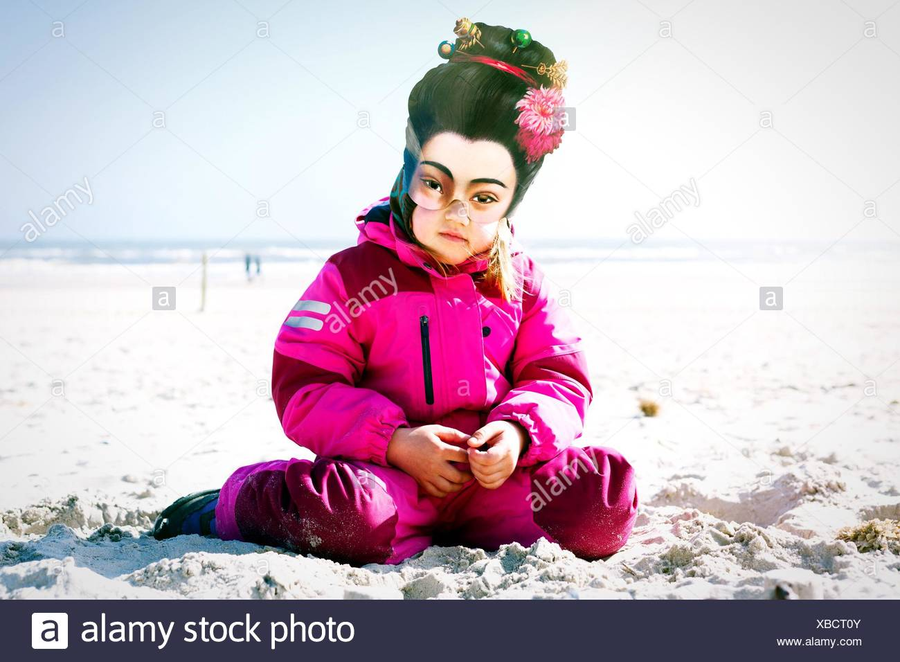 Child Wearing Mask On Sandy Beach - Stock Image