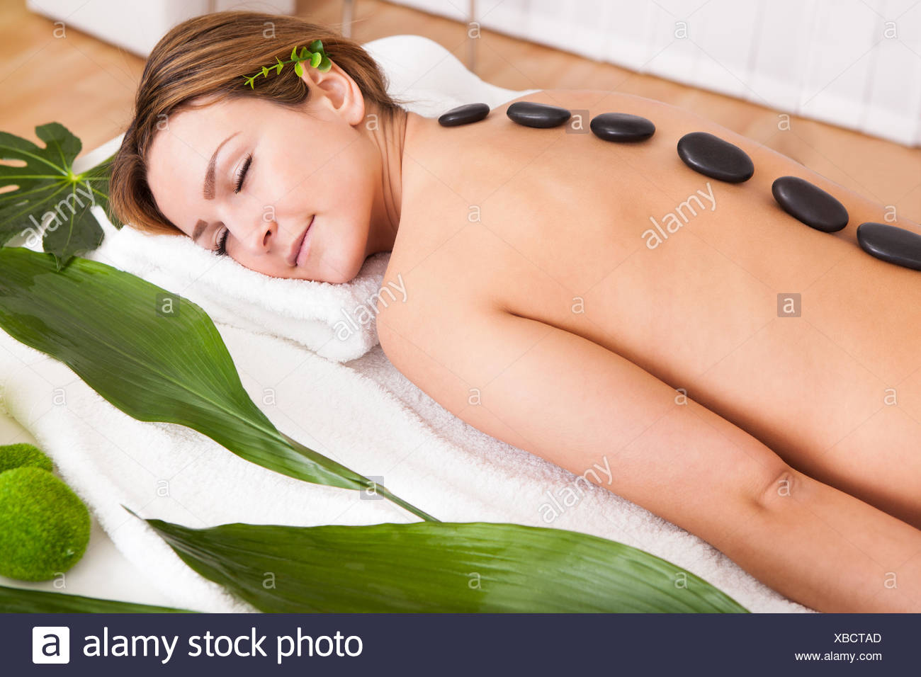 Portrait Of An Attractive Young Woman Lying In A Beauty Spa Stock Photo