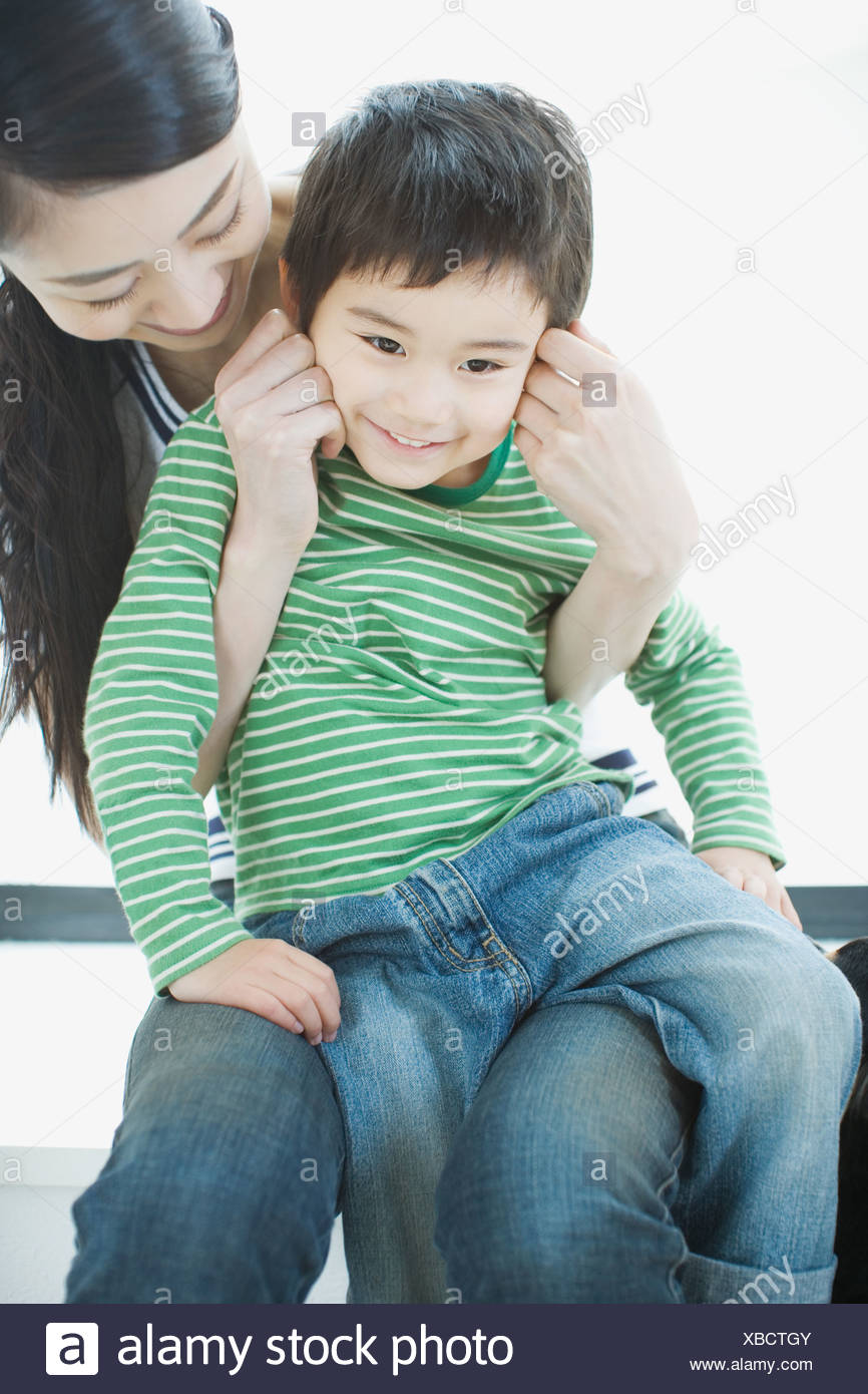 Asian mother with son - Stock Image