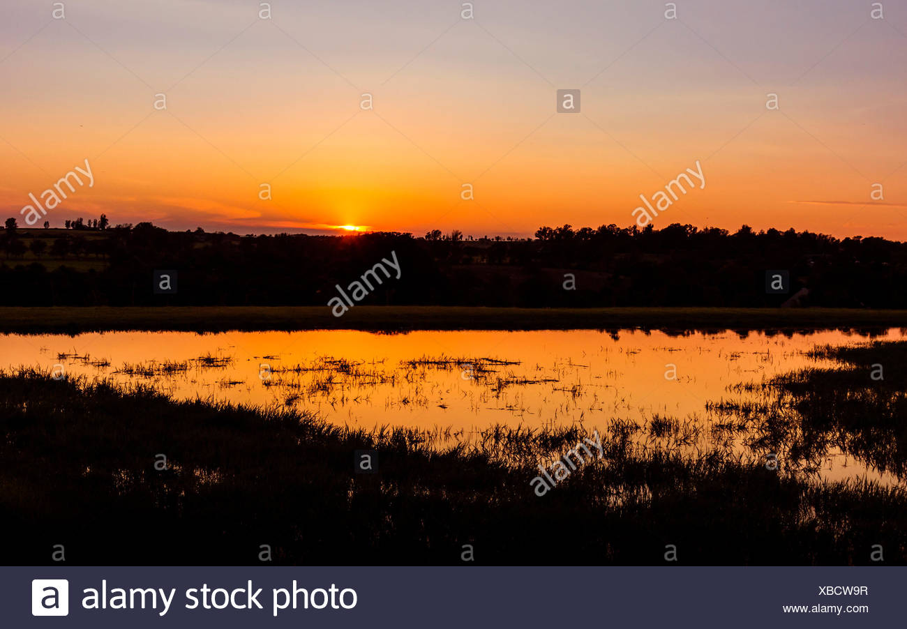 Monaghan farm, Lanseria, Province of Gauteng, Republic of South Africa. Small natural lake at sunset. - Stock Image