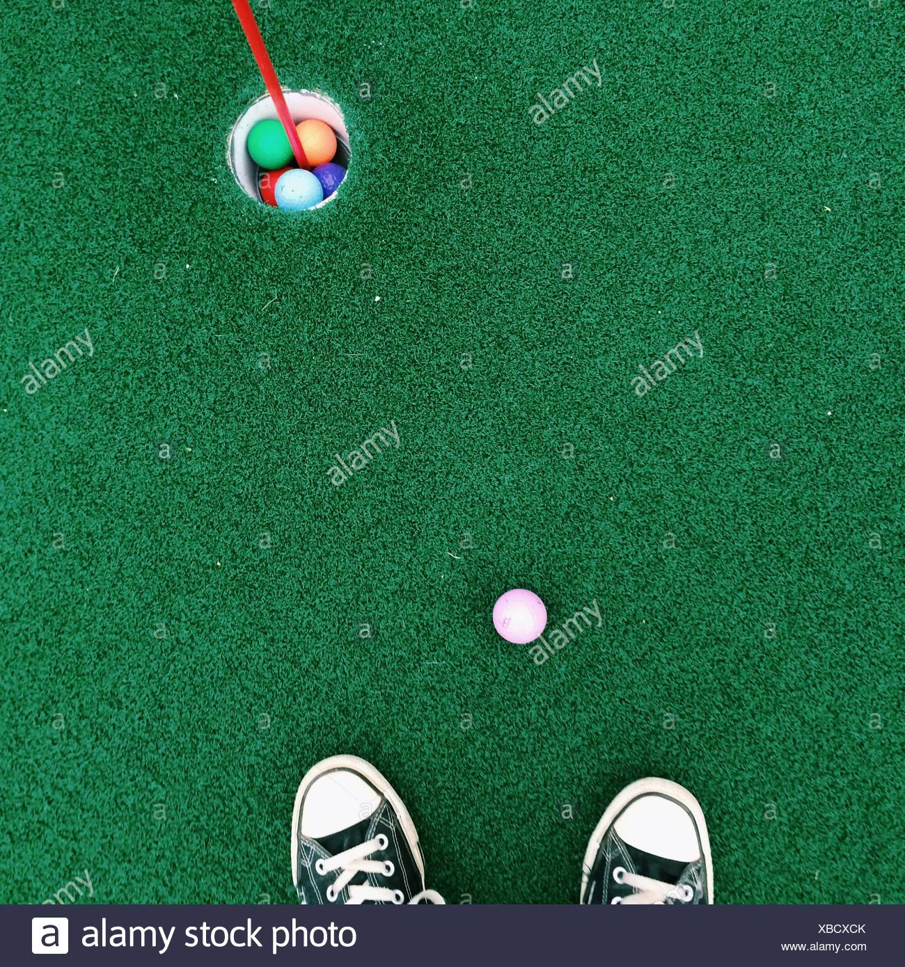 Feet on putting green - Stock Image