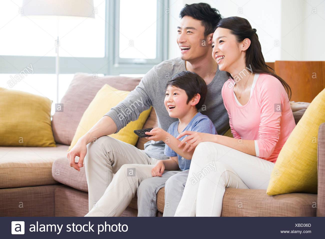 Happy family watching TV - Stock Image