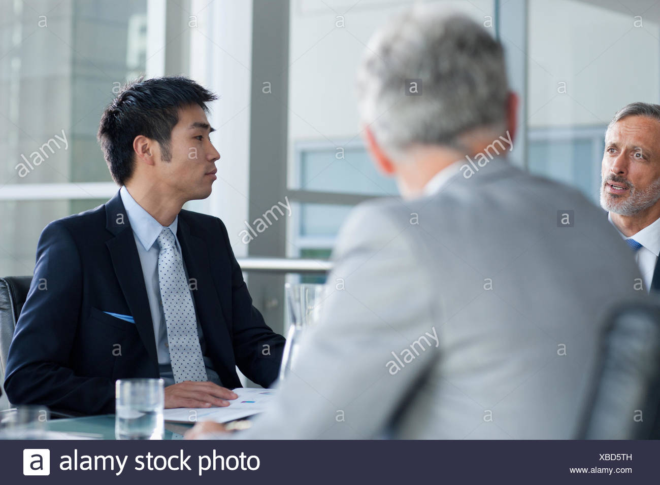 Businessman with co-workers - Stock Image