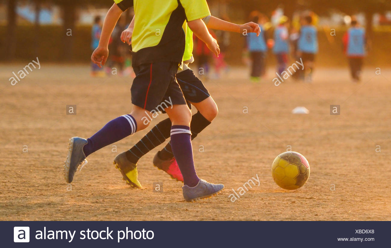 Practicing Soccer after School - Stock Image