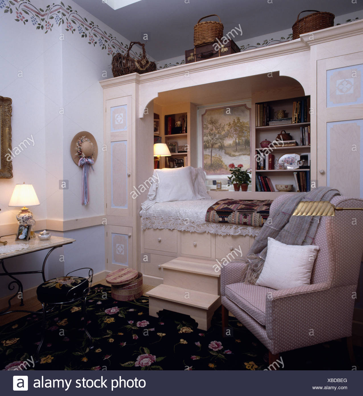 Steps Up To Platform Bed Built Into Alcove With Storage Cupboards In Eighties Bedroom Stock Photo Alamy