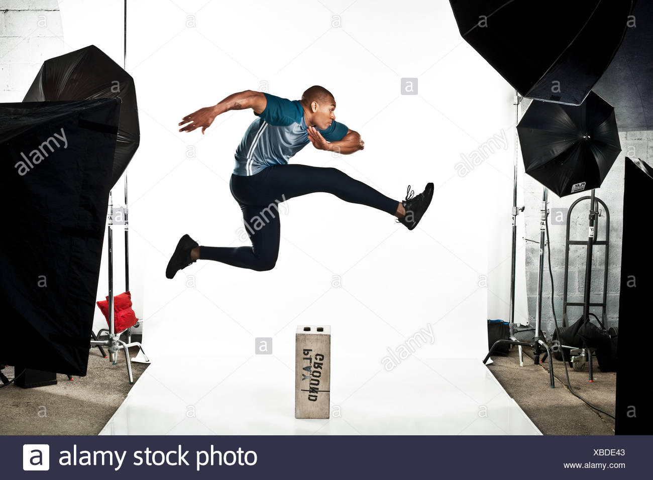 Athlete at photo shoot, jumping - Stock Image