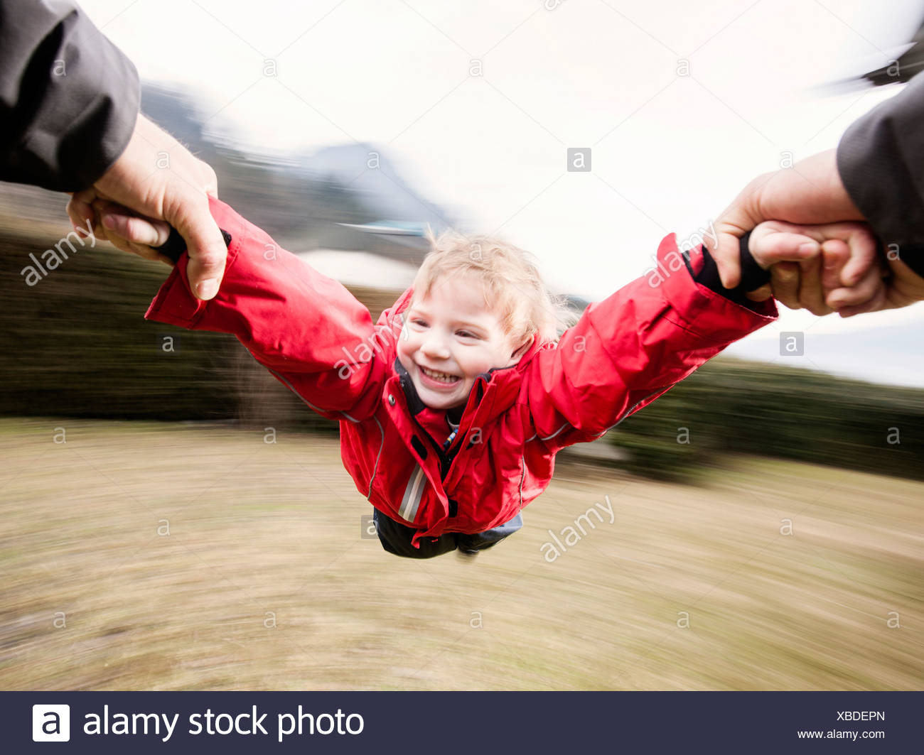 """Father letting his son """"fly"""" Stock Photo"""