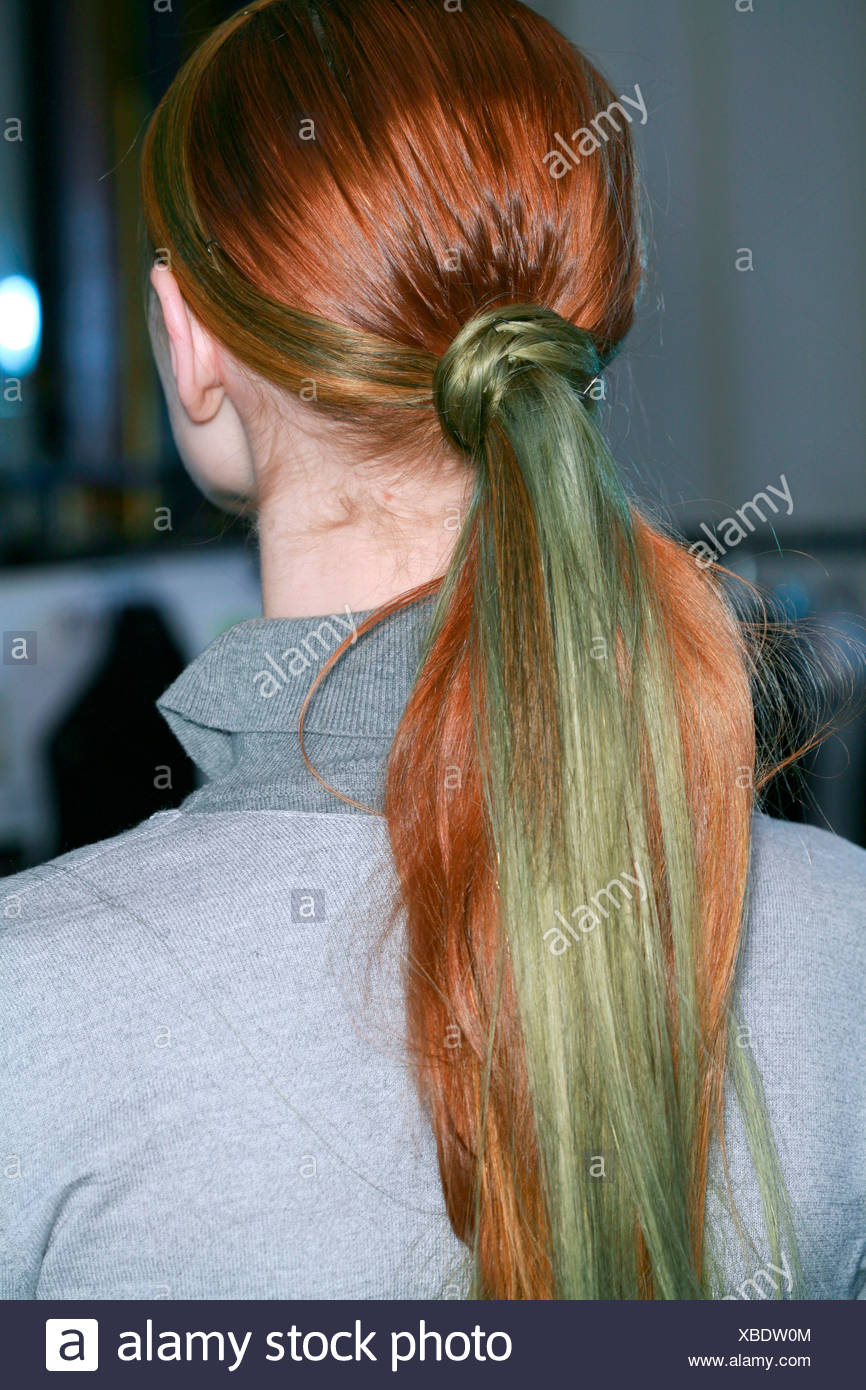Karl Lagerfeld Backstage Paris Ready to Wear Autumn Winter View from behind of mode with lonng red and green hair in ponytail Stock Photo