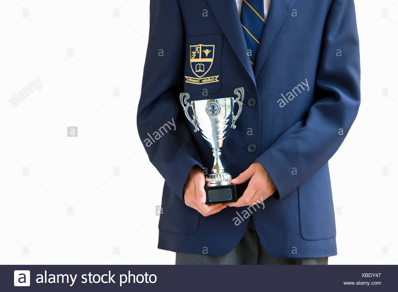 Cut Out Of Male School Pupil Holding Trophy - Stock Image