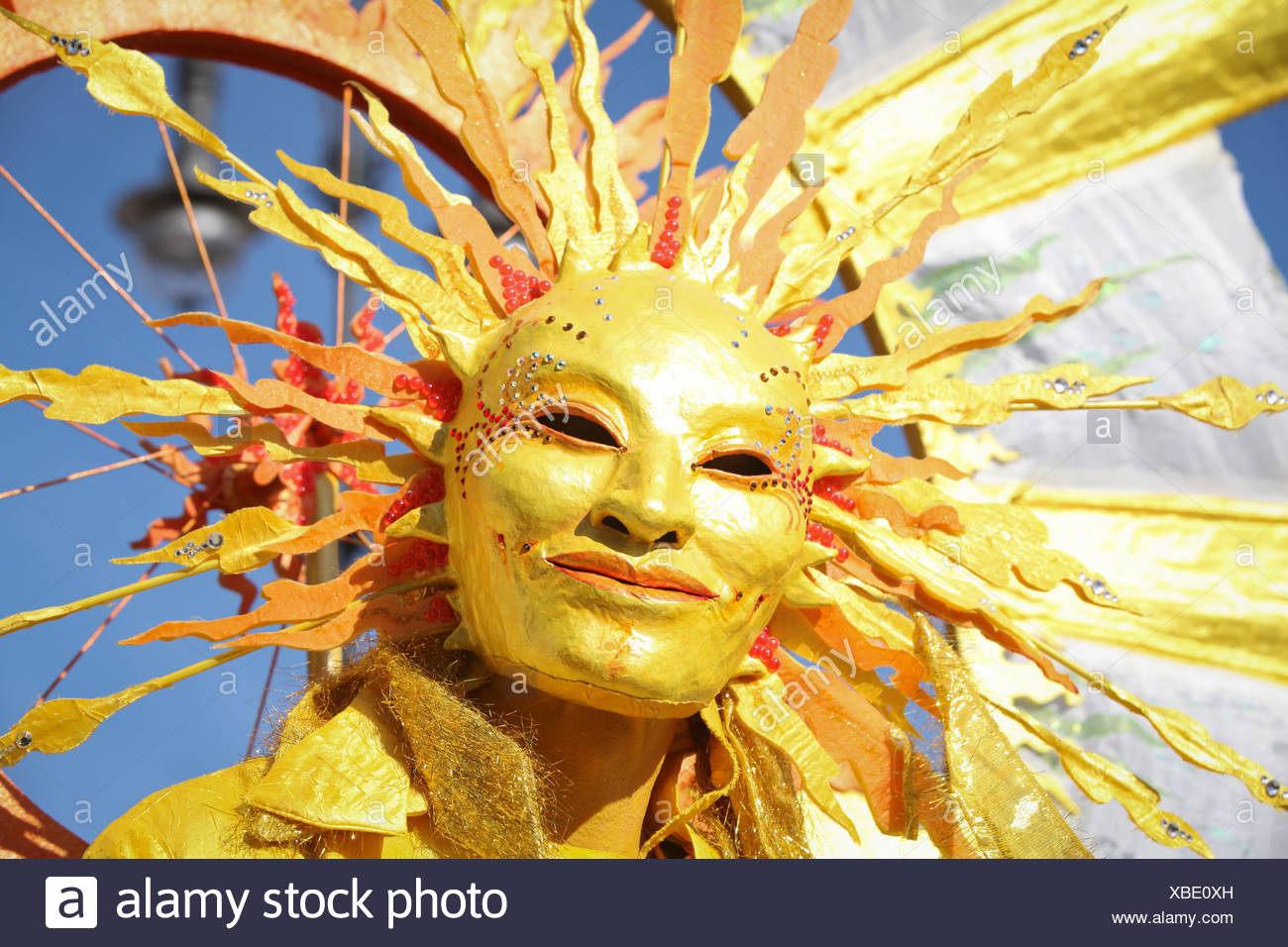 Sun mask, mass rally against drastic cuts in state funding for solar power, Berlin - Stock Image