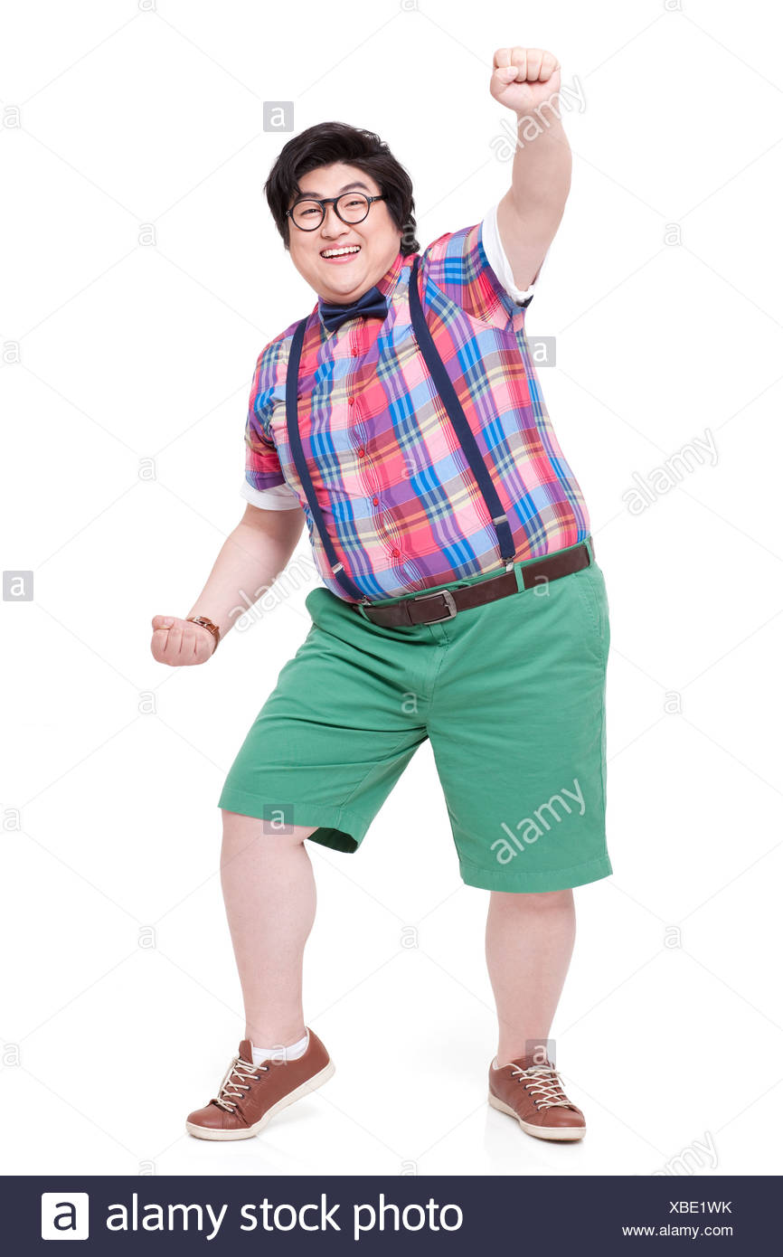Excited fat man punching the air - Stock Image