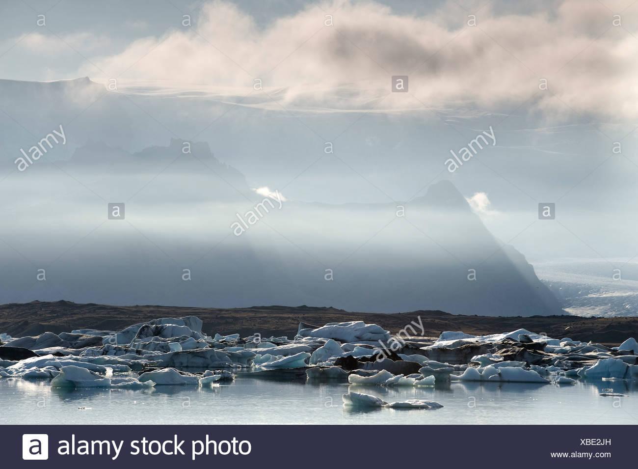 Icebergs floating in the Joekulsarlon glacier lagoon, South Iceland, Europe - Stock Image