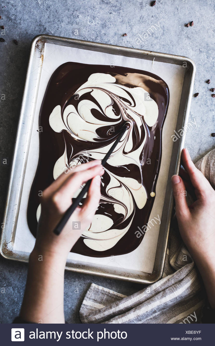 Melted white and dark chocolate - Stock Image