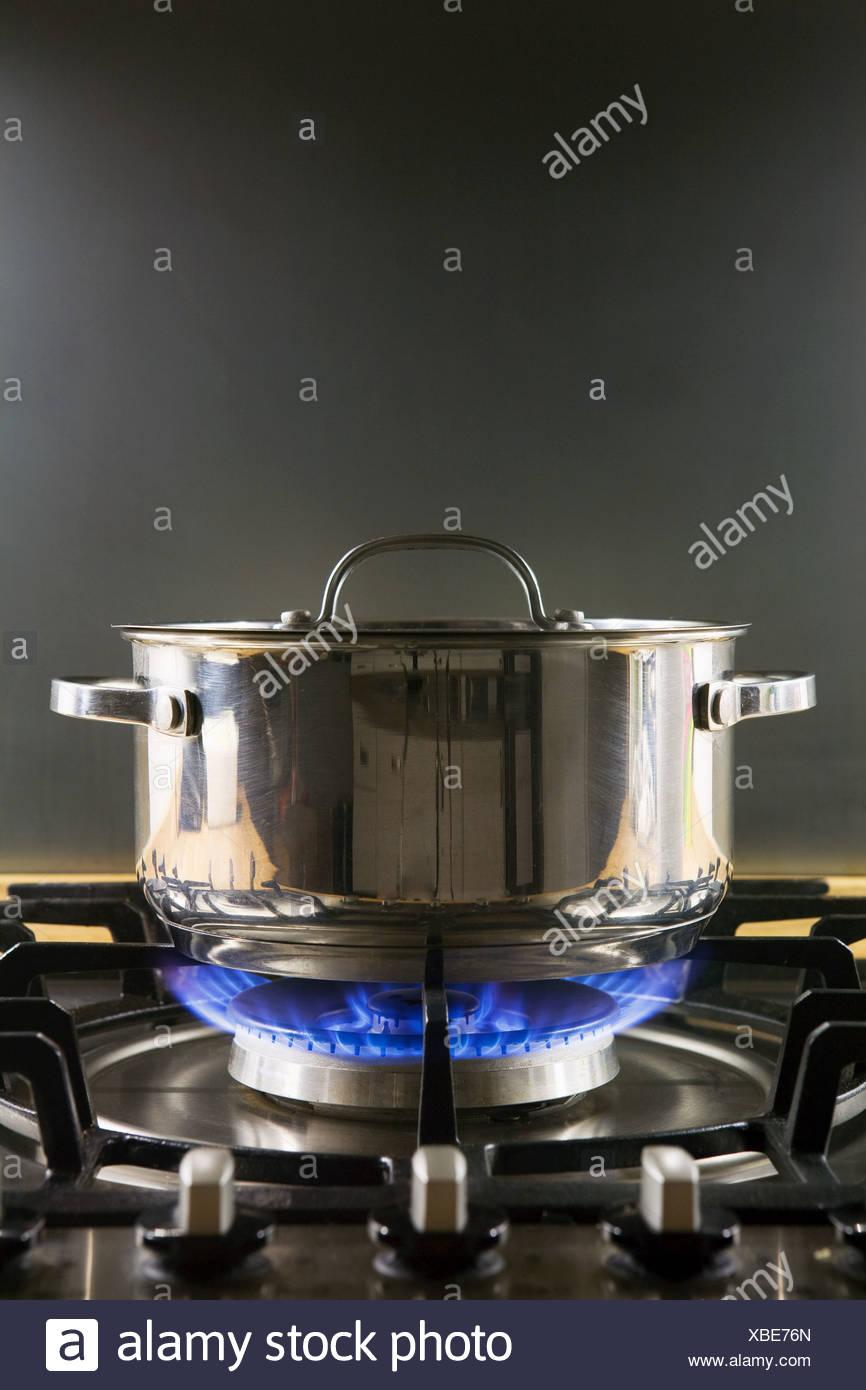 Pan on a gas hob Stock Photo