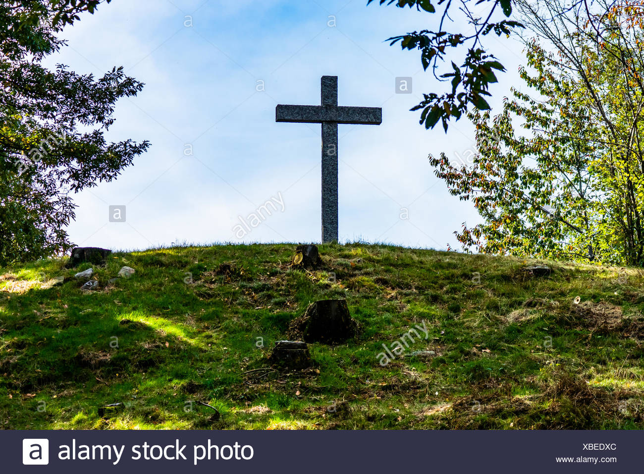 Low Angle View Of Cross On Field Against Sky - Stock Image