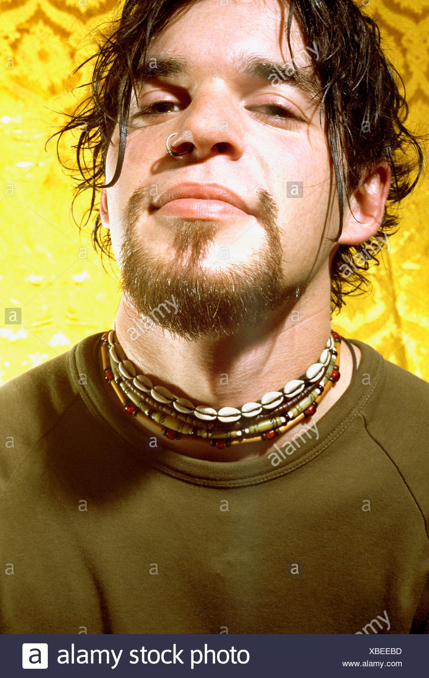 close up portrait of a young man with beard and pierced nose Stock Photo
