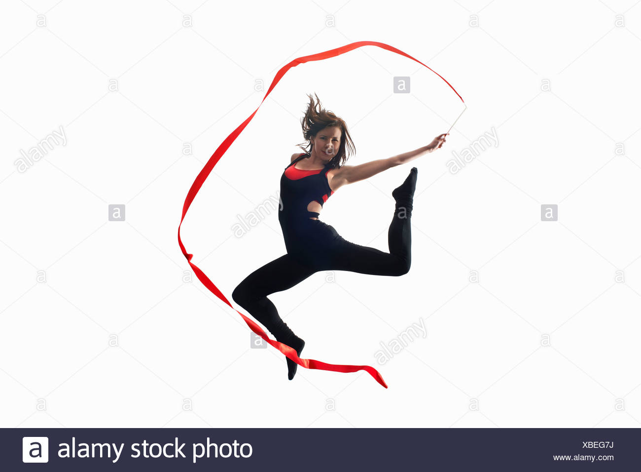 Dancer with ribbon on white background Stock Photo