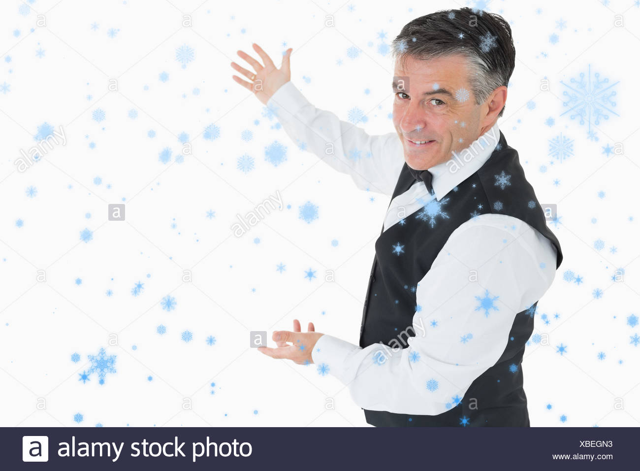Composite image of welldressed man showing us something - Stock Image