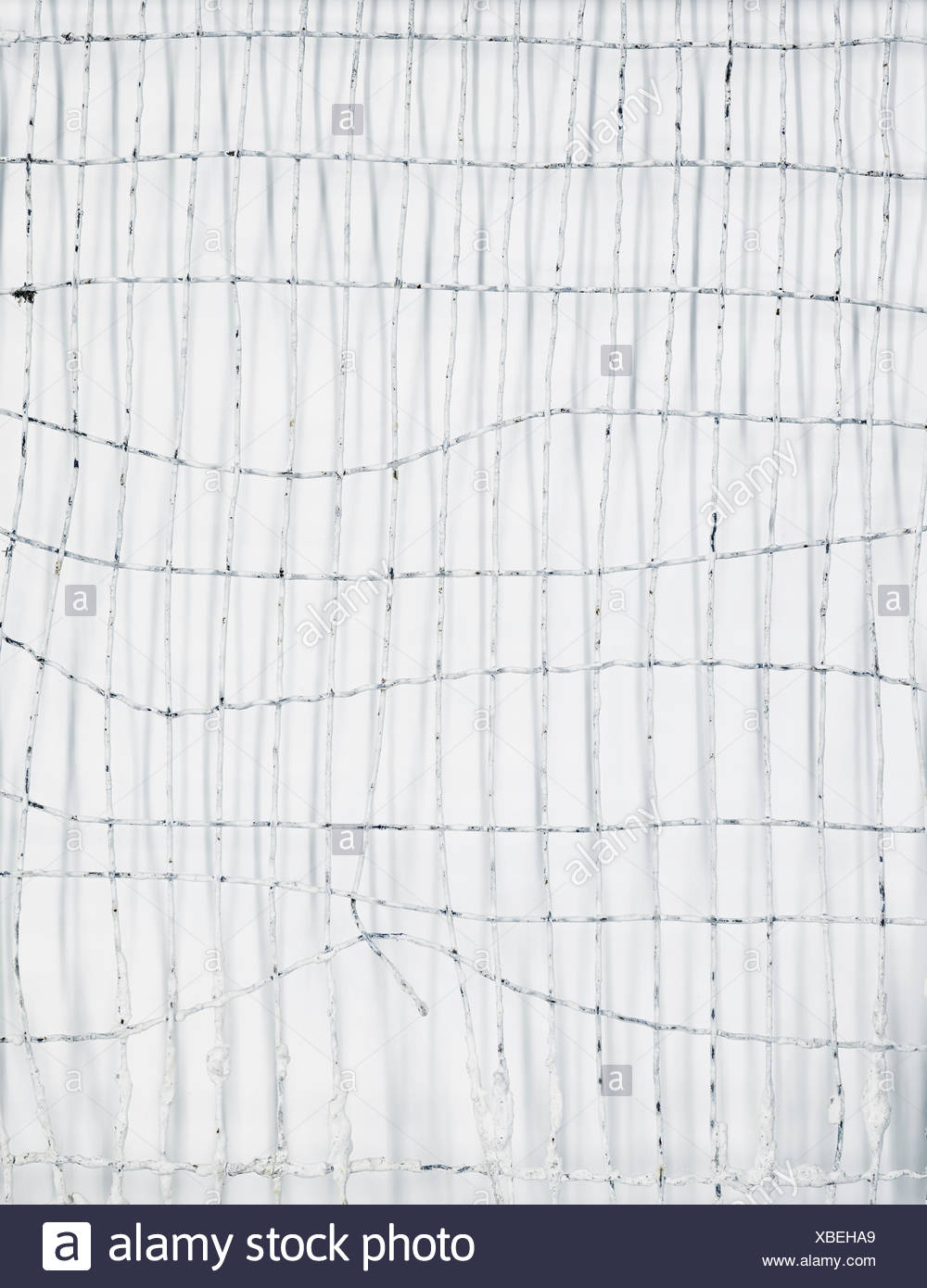 Grid made of metal wire, twisted, seen from above - Stock Image