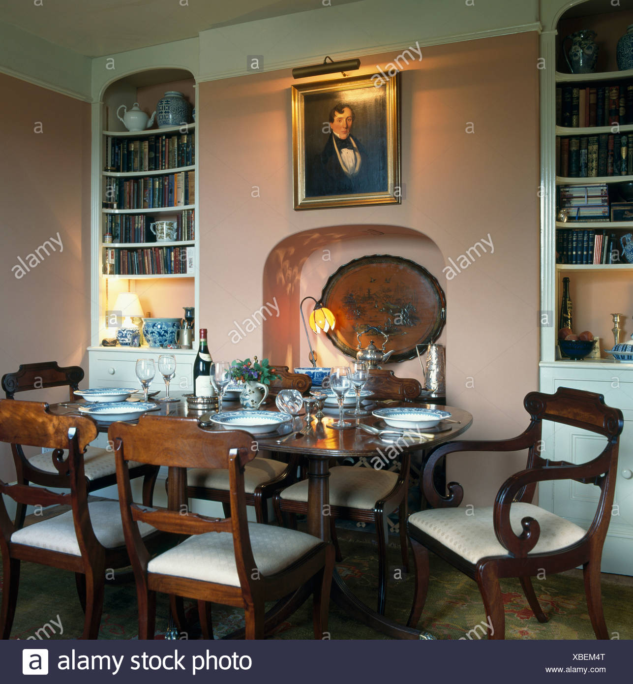 Beautiful Alcove Bookshelves In Pink Dining Room With Antique Furniture And Picture  Above Fireplace Alcove