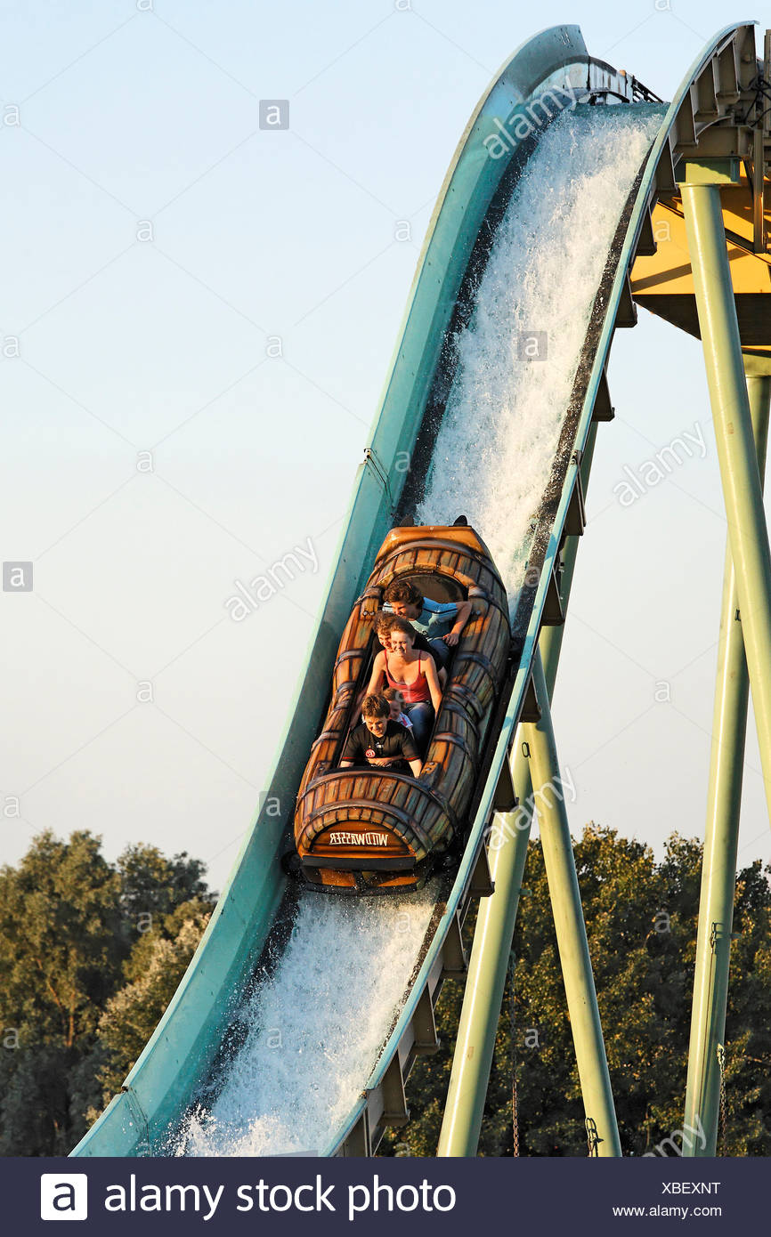 Group of young persons sliding downward on a torrent ride, Rhine funfair, Duesseldorf, NRW, Germany - Stock Image