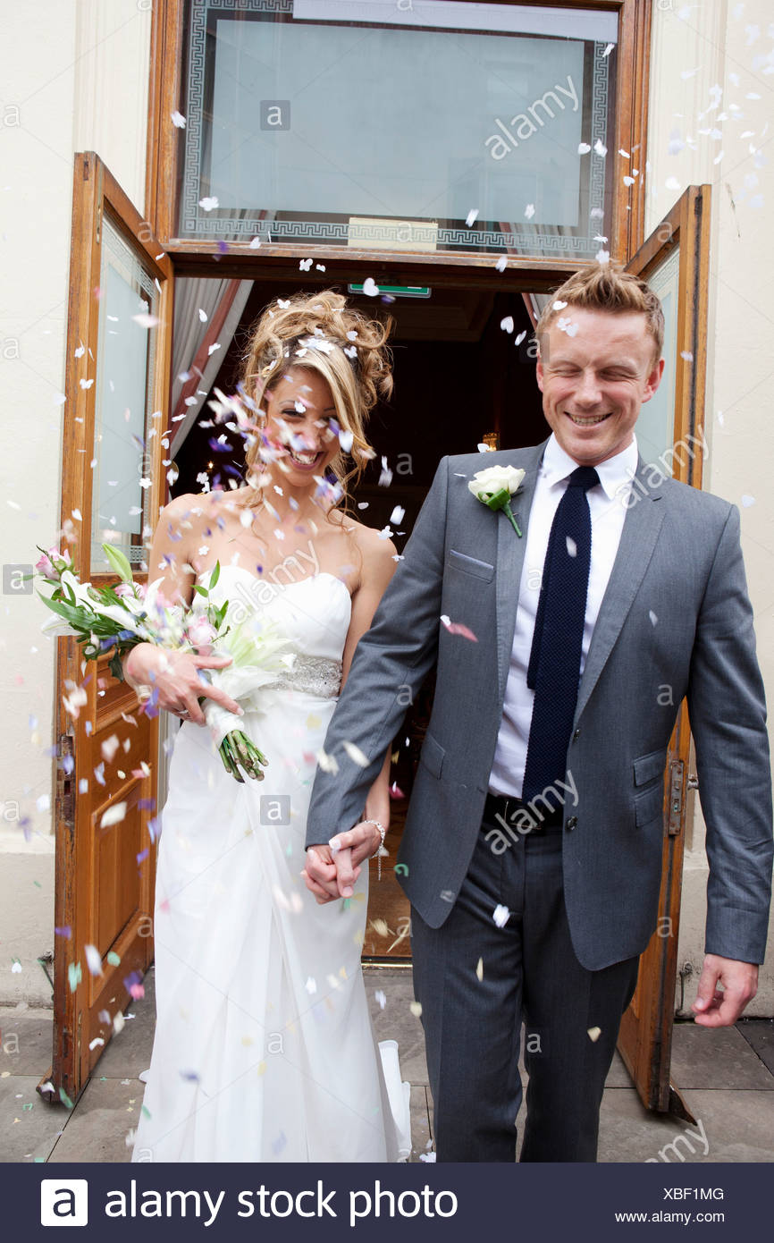Confetti thrown at bride and groom at wedding ceremony Stock Photo ...