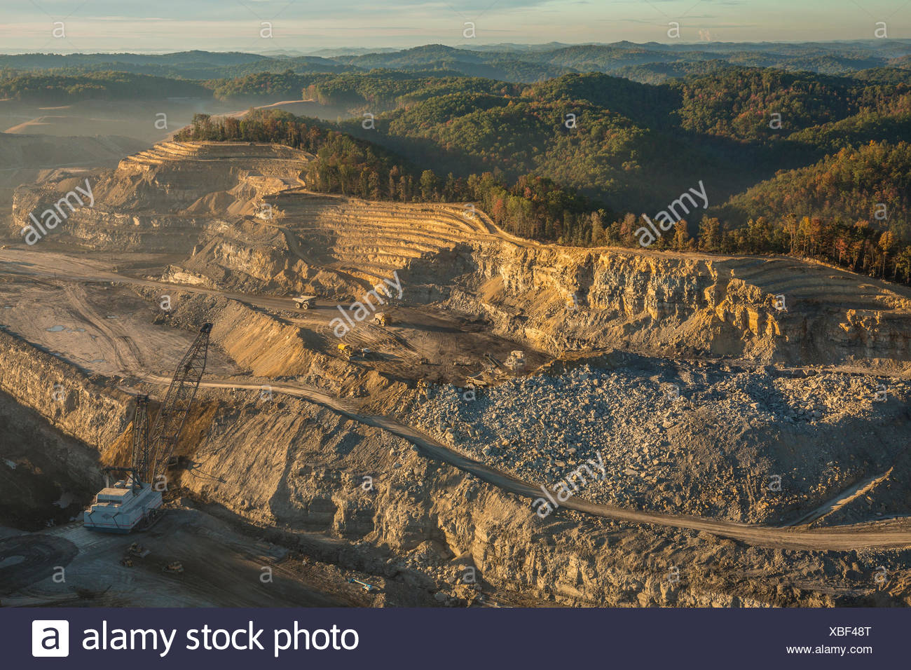 Explosives and heavy equipment are used to remove mountains to get at the seams of coal. - Stock Image