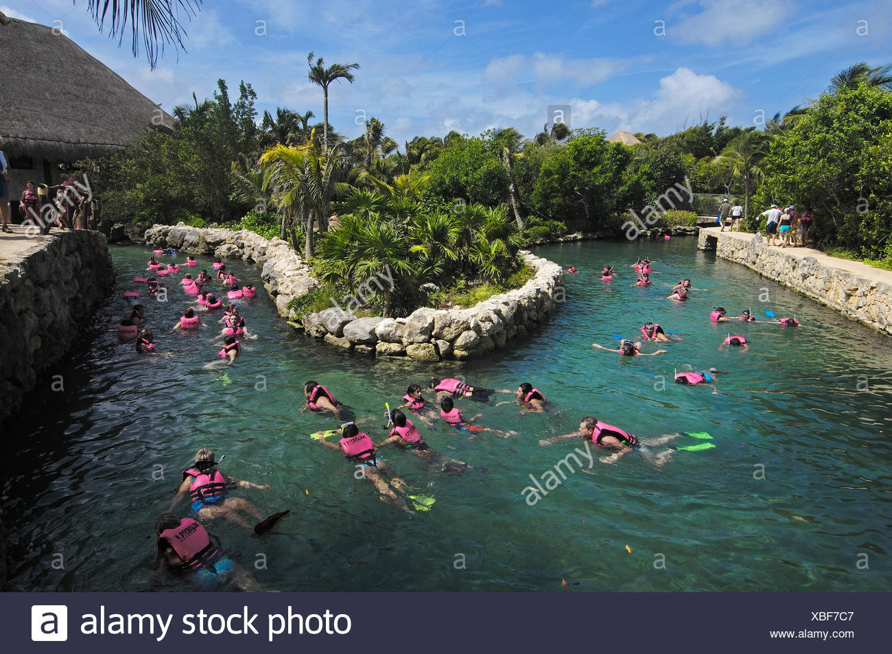 People Swimming In The Underground River Xcaret Eco Archeological Park Playa Del