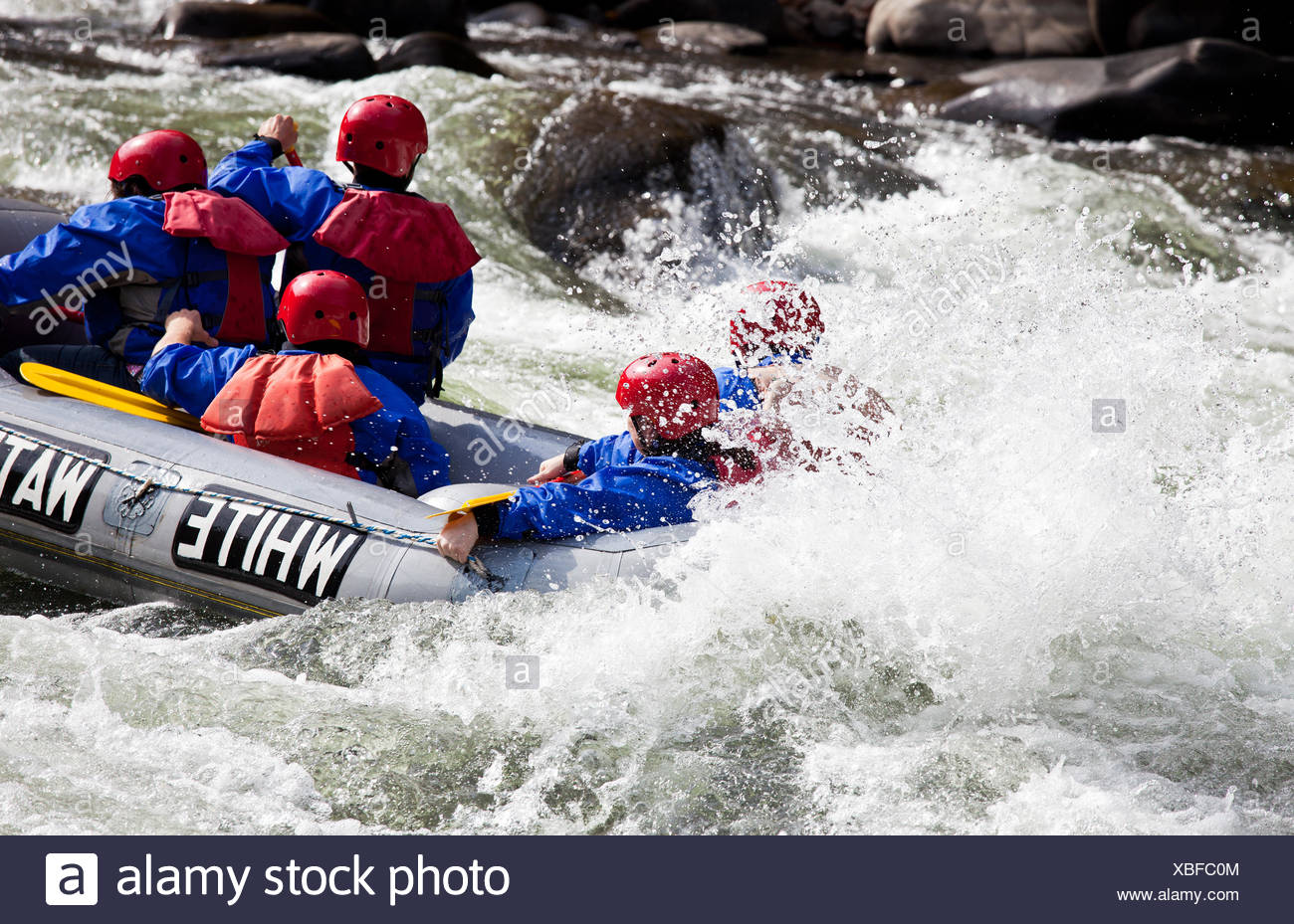 Group in out of control white water raft - Stock Image