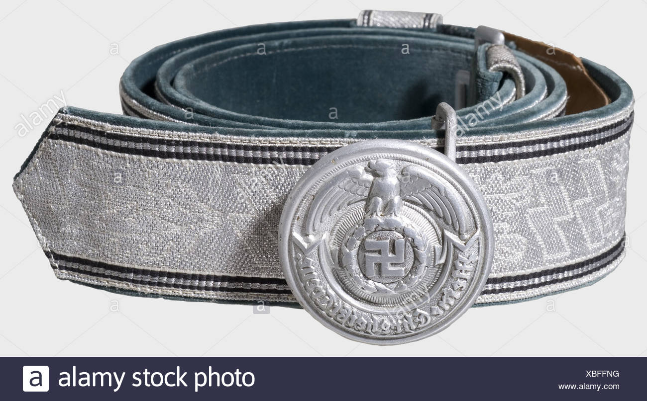 A belt for Leaders, of the Waffen-SS Aluminium closure, hollow-stamped one-piece buckle with multiple markings 'SS', 'RZM', '36/39' and 'OLC'. The belt is woven with silver brocade in alternating runes and oak leaves, green velvet liner. Complete with both slides and aluminium catch. Length 115 cm., historic, historical, 1930s, 1930s, 20th century, Waffen-SS, armed division of the SS, armed service, armed services, NS, National Socialism, Nazism, Third Reich, German Reich, Germany, military, militaria, utensil, piece of equipment, utensils, object, objects, sti, Additional-Rights-Clearances-NA - Stock Image