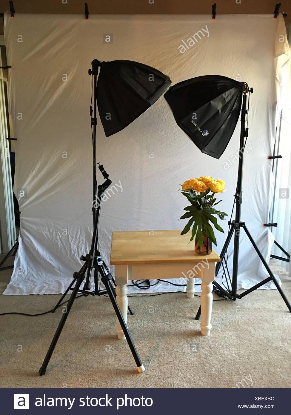Flower Vase On Table At Photo Studio - Stock Image