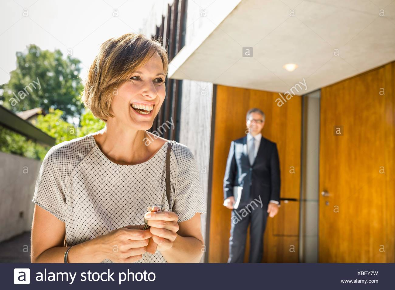 Mature woman with keys for new house - Stock Image