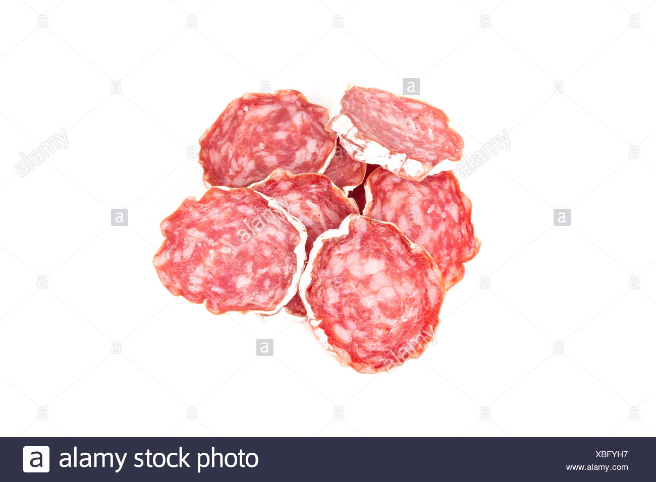 slices of salami isolated on a white - Stock Image