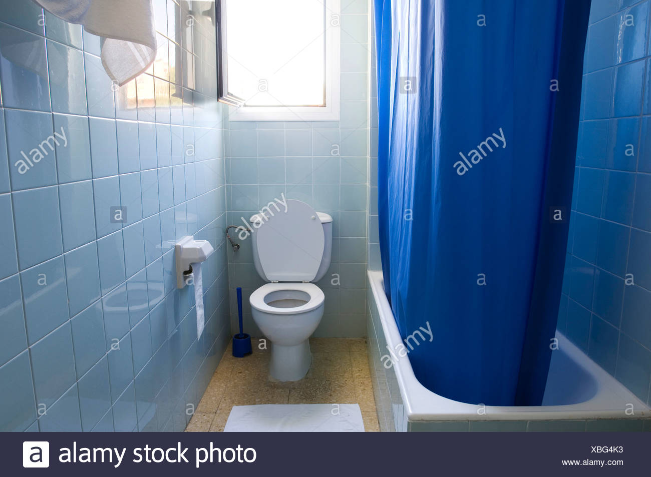 Bath, shower curtain and toilet in a bathroom Stock Photo: 282482007 ...