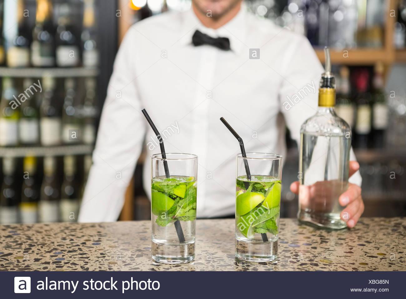 Bar tender making cocktails - Stock Image