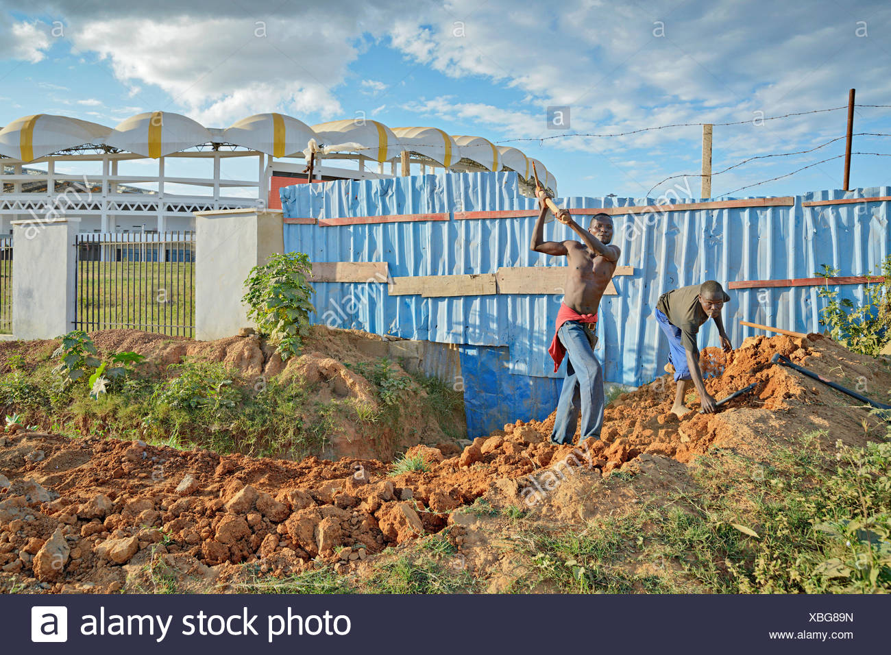 geography / travel, Zambia, Lusaka, Workers near the new Chinese-funded football stadium in Lusaka, the capital of Zambia., Additional-Rights-Clearance-Info-Not-Available - Stock Image