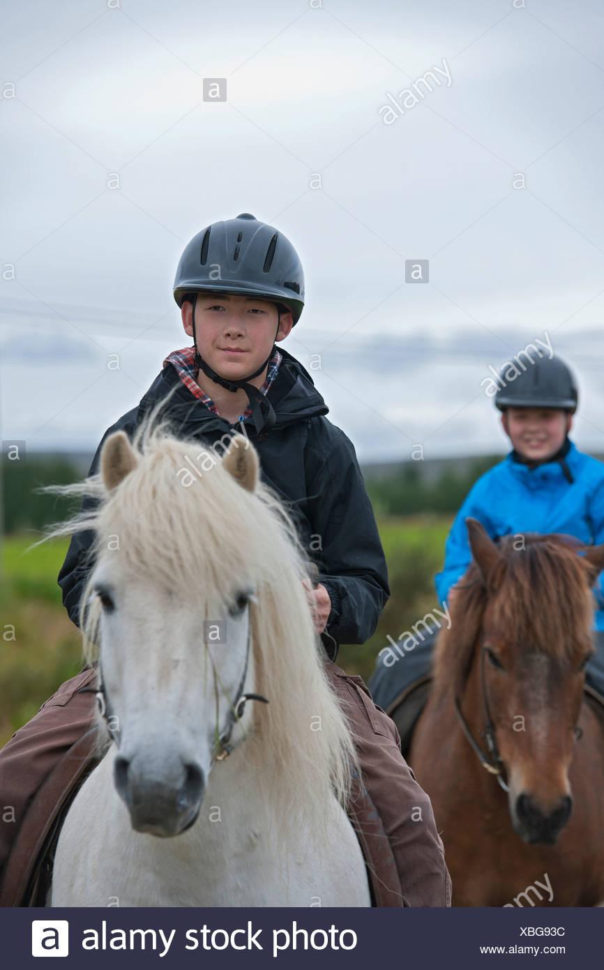 Children riding horses outdoors - Stock Image