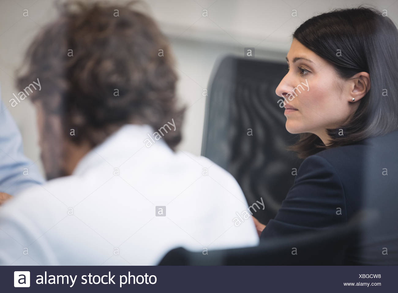 Businesswoman attending a meeting - Stock Image